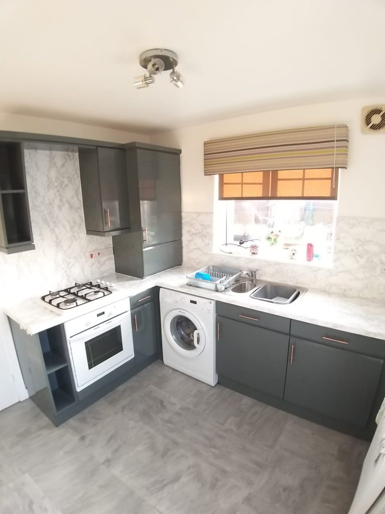 marble splash back and grey wrapped doors